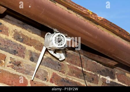 CCTV camera on outside of house, East Sussex, UK - Stock Photo