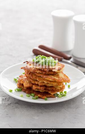 Classic Ukrainian dish deruny, potato pancakes on white plate - Stock Photo