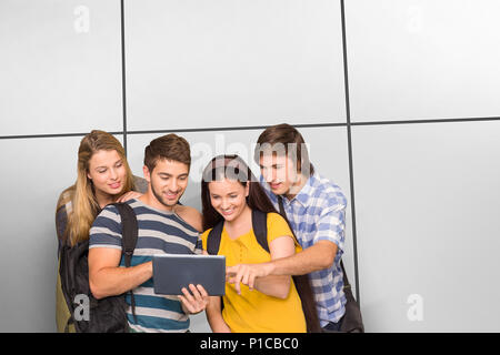 Composite image of students using digital tablet at college corridor - Stock Photo