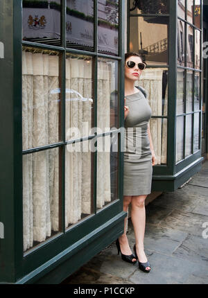 A woman standing on the street in New Orleans. Royal street. - Stock Photo