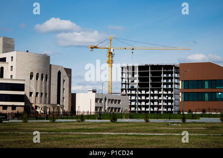 Cityscape. Ust-Kamenogorsk. Urban landscape. Building under construction. - Stock Photo