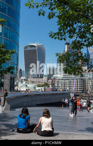 London, UK. 11th June, 2018. UK Weather. The temperature reaches 24 degrees in the summer sunshine at London Bridge in the city of London. Office workers and tourists making the most of the warm sunshine taking their lunch breaks by the river thames with view over the city beyond. The iconic London city skylin serves as a backdrop for the hundreds of people enjoying the seaonal hot temperature in the capital. Credit: Steve Hawkins Photography/Alamy Live News Stock Photo