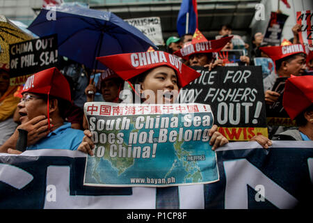 Manila, Philippines. 1st Jan, 2000. Various militant groups protest in front of the Chinese consulate in Makati City, Philippines in celebration of the 120th Philippine Independence Day on Tuesday. June 12, 2018. The groups condemn the ongoing dispute between the Philippines and China in the South China Sea. Credit: Basilio H. Sepe/ZUMA Wire/Alamy Live News - Stock Photo