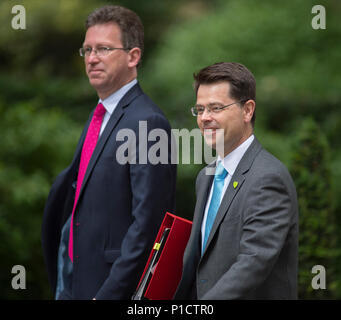 Downing Street, London, UK. 12 June 2018. Jeremy Wright QC, Attorney General in Downing Street for weekly cabinet meeting, arriving with James Brokenshire, Secretary of State for Housing, Communities and Local Government wearing a Grenfell Green Lapel Badge. Credit: Malcolm Park/Alamy Live News. - Stock Photo