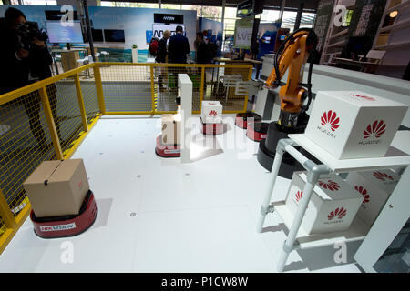 A robot arm at the Huawei booth will be loading a parcel, parcel center, logistics, goods handling, CeBIT International Fair in Hanover, on 11.06.2018. | usage worldwide - Stock Photo