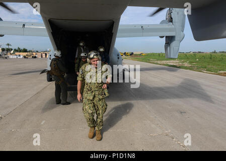 Port au Prince, HAITI (Oct. 14, 2016) – Rear Adm. Roy Kitchener, commander, Expeditionary Strike Group Two, arrives at Toussaint Louveture International Airport.  Joint Task Force Matthew is providing disaster relief and humanitarian aid to Haiti following Hurricane Matthew. (U.S. Navy photo by Petty Officer 3rd Class Jess E. Toner/Released) - Stock Photo