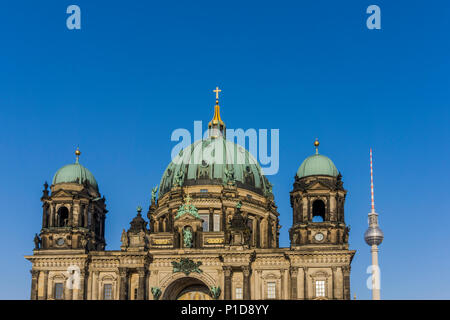 Berlin Cathedral with Tv Tower Against Clear Sky - Stock Photo