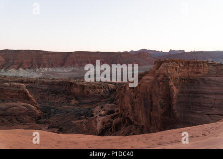 A pink sunset view over Arches National Park, Utah. - Stock Photo