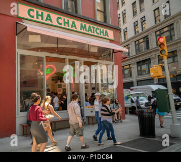 People line up for their fix of matcha at Cha Cha Matcha in the NoMad neighborhood of New York on Thursday, May 24, 2018. The popular beverage, matcha, is ground green tea and is used in Cha Cha Matcha to make instagrammable beverages popular with millennials. Loaded with antioxidants matcha supposedly has medicinal qualities. (© Richard B. Levine) - Stock Photo
