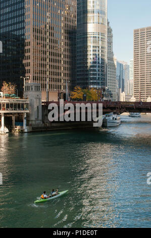 People kayaking on the main stem of the Chicago River in downtown Chicago. - Stock Photo