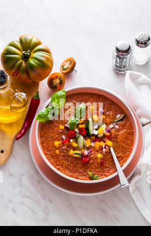 Traditional spanish andalusian tomato cream soup - salmorejo. Salmorejo or gazpacho cream soup on gray bowl - Stock Photo