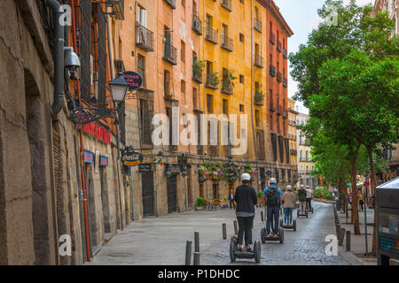 Segway city Europe, tourists on segways in the Calle Cuchilleros take a tour of the Old Town in Madrid, Spain. - Stock Photo