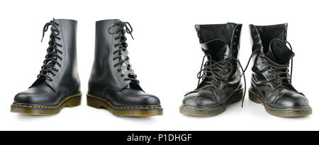 One and the same pair of black men's boots. New and worn out. Isolated on white background. - Stock Photo