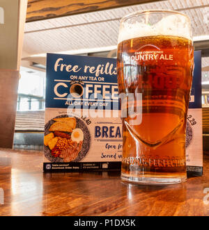 A pint of craft beer in front of menu in JD Wetherspoon pub in England. UK - Stock Photo