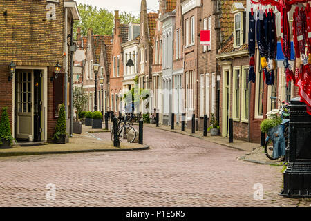 street in the tourist center in the village of edam with its old traditional houses cobbled streets and bicycles. netherlands - Stock Photo