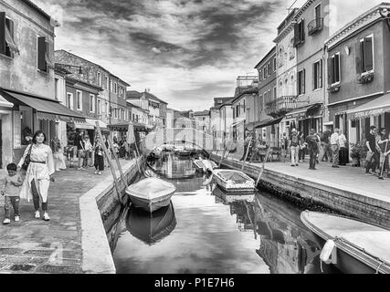 VENICE, ITALY - APRIL 30: Scenic houses along the canal on the island of Burano, Venice, Italy, April 30, 2018 - Stock Photo