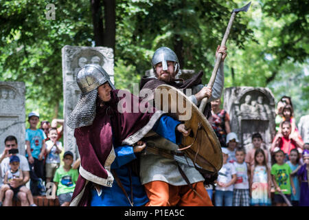 Nis, Serbia - June 10, 2018: Two knight fighting during Middle Ages festival in nature and public watching. Medieval battle concept - Stock Photo