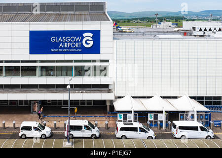 Front facade of Glasgow International Airport with the taxi rank in front and the runways behind, Glasgow, Scotland, - Stock Photo