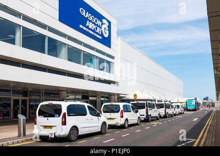 Main entrance to Glasgow International airport with the iconic white taxis at the taxi rank, Glasgow, Scotland, - Stock Photo