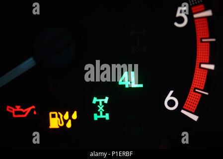 Warning signs of 4x4 car in modern dashboard macro view