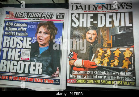 Headlines of New York tabloid newspapers are seen on Wednesday, May 30, 2018 reporting on the cancellation by ABC of 'Roseanne' because of racist comments made by the titular star Roseanne Barr referencing former Obama aide Valerie Jarrett. (© Richard B. Levine) - Stock Photo