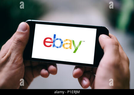 Closeup of iPhone Screen with eBay LOGO or ICON on smartphone - Stock Photo