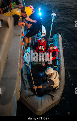 161019-N-SB587-1269    Sailors lower 5-meter rigid-hull inflatable boat from the mine countermeasure ship USS Dextrous (MCM 13) as part of U.K./U.S . Mine Countermeasures Exercise 17-1 in the Arabian Gulf Oct. 19, 2016. The exercise is a bilateral mine countermeasures (MCM) exercise between the U.S. Navy and Royal Navy designed to provide an opportunity for both nations to share knowledge of MCM techniques to respond to mine threats. The combined MCM force will enhance MCM capabilities in searching, identifying and neutralizing mines threatening the freedom of navigation and free flow of comme - Stock Photo