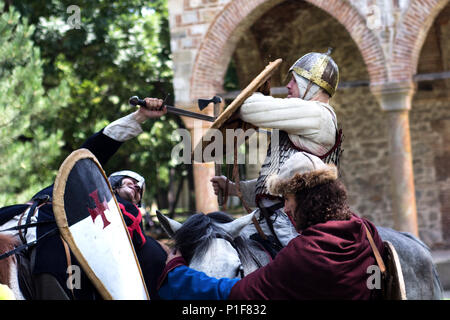 Nis, Serbia - June 10, 2018: Medieval knight battle on horse with swords and armor. Middle ages fight concept - Stock Photo