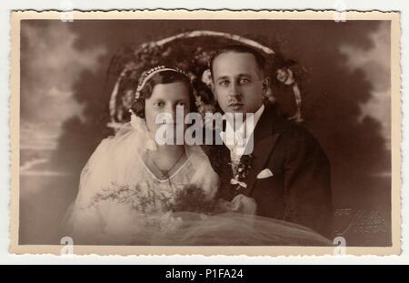 CHRASTAVA (KRATZAU), THE CZECHOSLOVAK  REPUBLIC - CIRCA 1930s: Vintage photo of newlyweds. Black & white antique studio portrait. - Stock Photo