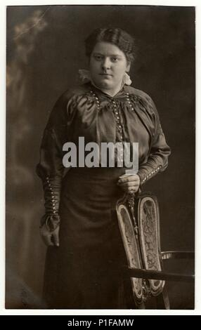 AUSTRIA-HUNGARY - CIRCA 1910s: Vintage photo shows mature woman poses in a photography studio. Black & white antique studio portrait. - Stock Photo