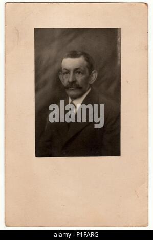 THE CZECHOSLOVAK REPUBLIC - CIRCA 1930s: Vintage photo shows man. Photo with wide frame. Black & white studio portrait. - Stock Photo