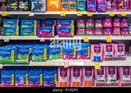 A variety of sanitary napkins placed on shelf in supermarket for customers to choose. Melbourme, VIC Australia. - Stock Photo