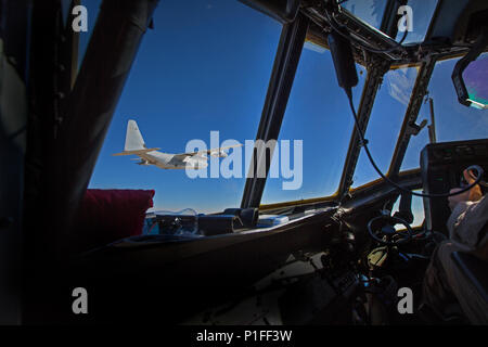 A KC-130J with Marine Aerial Refueler Transport Squadron 352, takes part in a Special Purpose Marine Air-Ground Task Force - Crisis Response - Central Command aerial refueling exercise, Oct. 13, 2016. SPMAGTF-CR-CC is a self-sustaining expeditionary unit, designed to provide a broad range of crisis response capabilities throughout the Central Command area of responsibility, using organic aviation, logistical, and ground combat assets, to include TRAP and embassy reinforcement. (U.S. Marine Corps photo by Cpl. Trever Statz) - Stock Photo