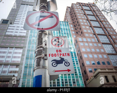 No parking sign for motorcycles on pedestrian footpath in Melbourne's CBD. VIC Australia. - Stock Photo