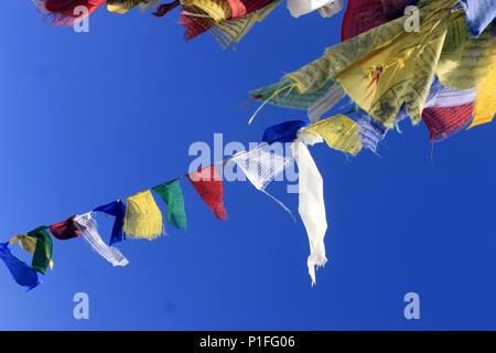 Sikh praying flags besides the Gurudongmar Lake. On the way to Gurudongmar lake. - Stock Photo