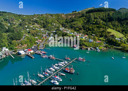Fishing Boats at Carey's Bay Wharf and Otago Harbour, Port Chalmers, Dunedin, Otago, South Island, New Zealand - drone aerial - Stock Photo