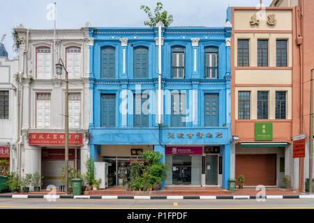 Singapore - June 10, 2018: Colorful Shophouses in Chinatown with closed shoppes - Stock Photo