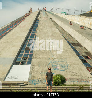 People having fun at the 'Pyramid' of Tirana, an unusual building and formerly the Enver Hoxha Museum. Albania - Stock Photo