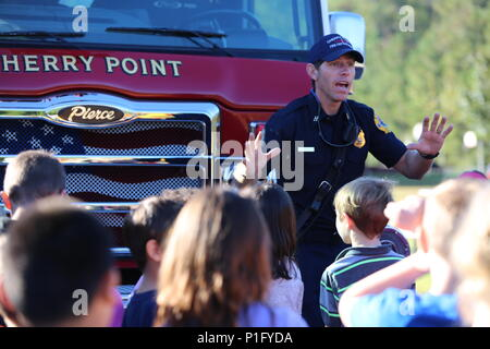 Edward Hudson explains the functions of a ladder truck to students
