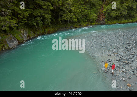Tourists by Makarora River, Blue Pools, Mount Aspiring National Park, Haast Pass, near Makarora, Otago, South Island, New Zealand (model released) - Stock Photo