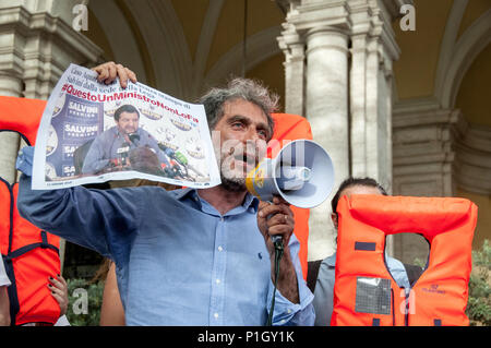 Rome, Italy. 11th June, 2018. Demonstration in front of the transport ministry in Rome with the password #portiaperti against the decision of the Minister of the Interior Salvini to close the Italian ports - in violation of the laws of the sea, of international law and of humanity - denying the berth to the Acquarius ship with 629 people saved in the Mediterranean on Saturday Credit: Patrizia Cortellessa/Pacific Press/Alamy Live News - Stock Photo