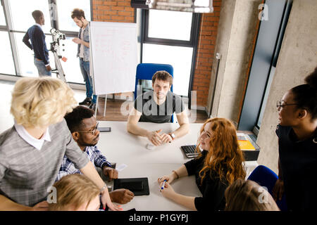 youth taking part in sociological research on trade - Stock Photo