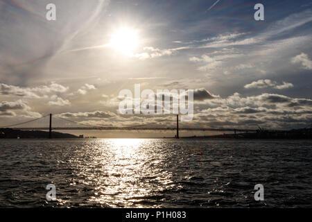 Lisboa sunset bridge view Ponte 25 de Abril - Stock Photo