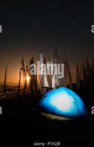Spending a windy night under the orange moonlight at 4000 meters in Bhutan at the highest pass Chele la - Stock Photo