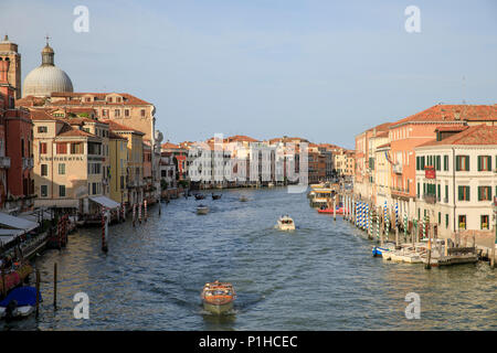 View from Ponte degli Scalzi at sunset looking down the Grand Canal in Venice, Italy. - Stock Photo