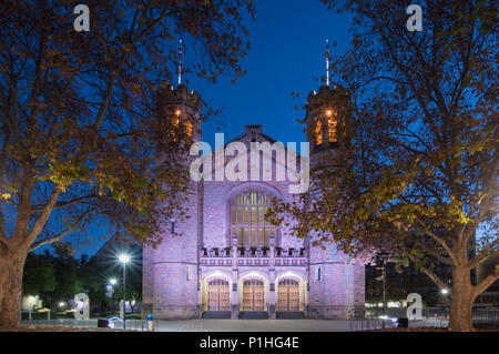 The Bonython Hall in Adelaide is lit up at night with purple lights. - Stock Photo