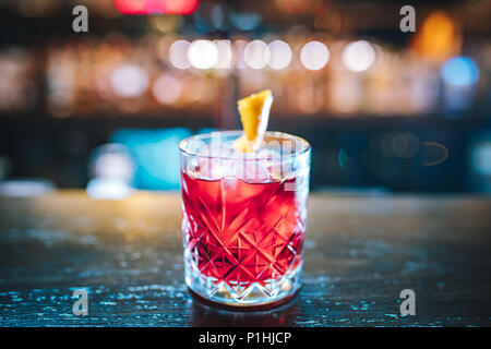 Pink and red Fresh colorful exotic alcoholic cocktail with lemon and ice in the bar. Colorful pink Soft drink with ice on the bar desk Colorful Mojito - Stock Photo