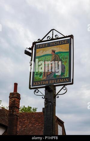 The Kentish Rifleman pub sign in Dunks Green near Hadlow, Kent, UK - Stock Photo