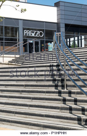Looking up a sweeping flight of steps to a modern building housing Prezzo Italian Restaurant, St Stephens Leisure Park, Trowbridge, Wiltshire, England - Stock Photo