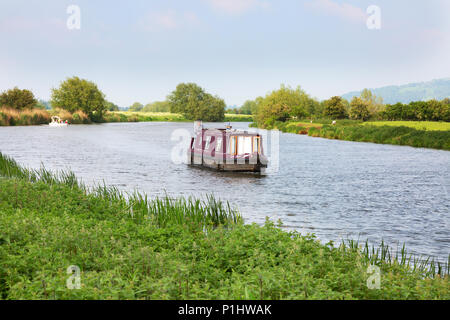 A narrow boat or canal boat on the River Avon at Tewkesbury, Gloucestershire England UK - Stock Photo